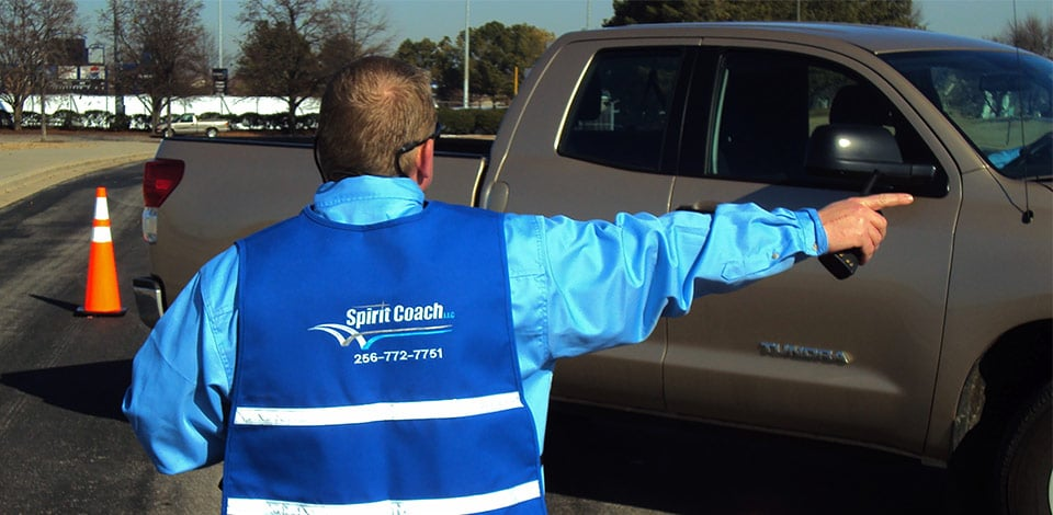 Spririt Coach team member directing traffic at event